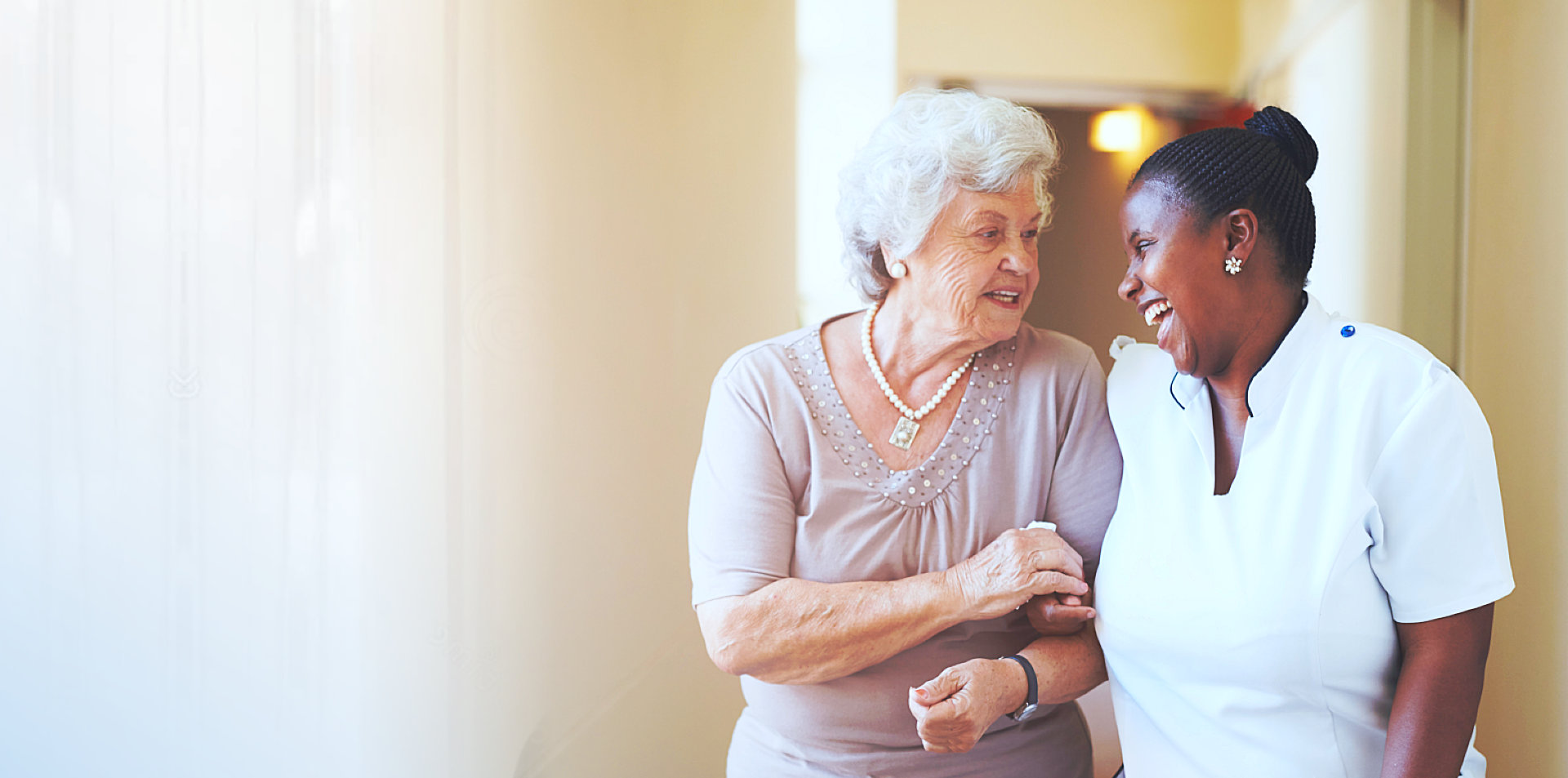 caregiver and senior woman talking while walking